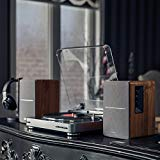 The Edifier R1280T on a table with a DJ turntable and headphones