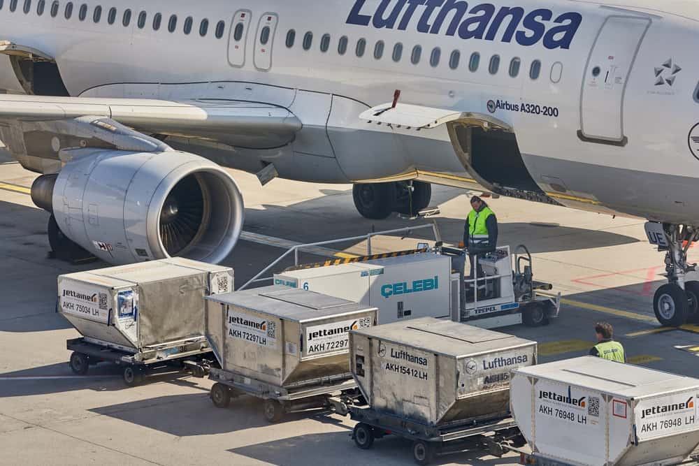 dj equipment being loaded on to aeroplane