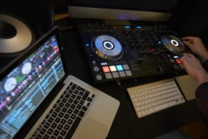 Cut in of DJ Decks and Laptop Computer