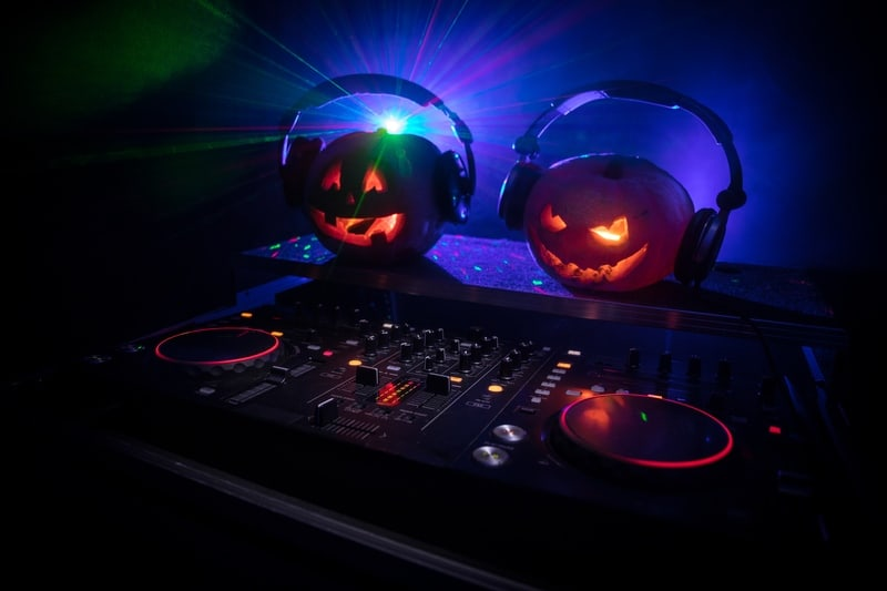 halloween pumpkin DJ party club with headphones